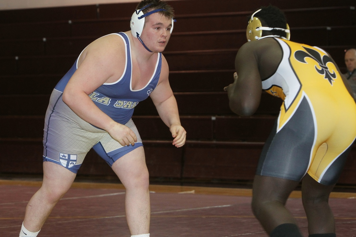 Wrestling Team Advances to Catholic League Playoffs